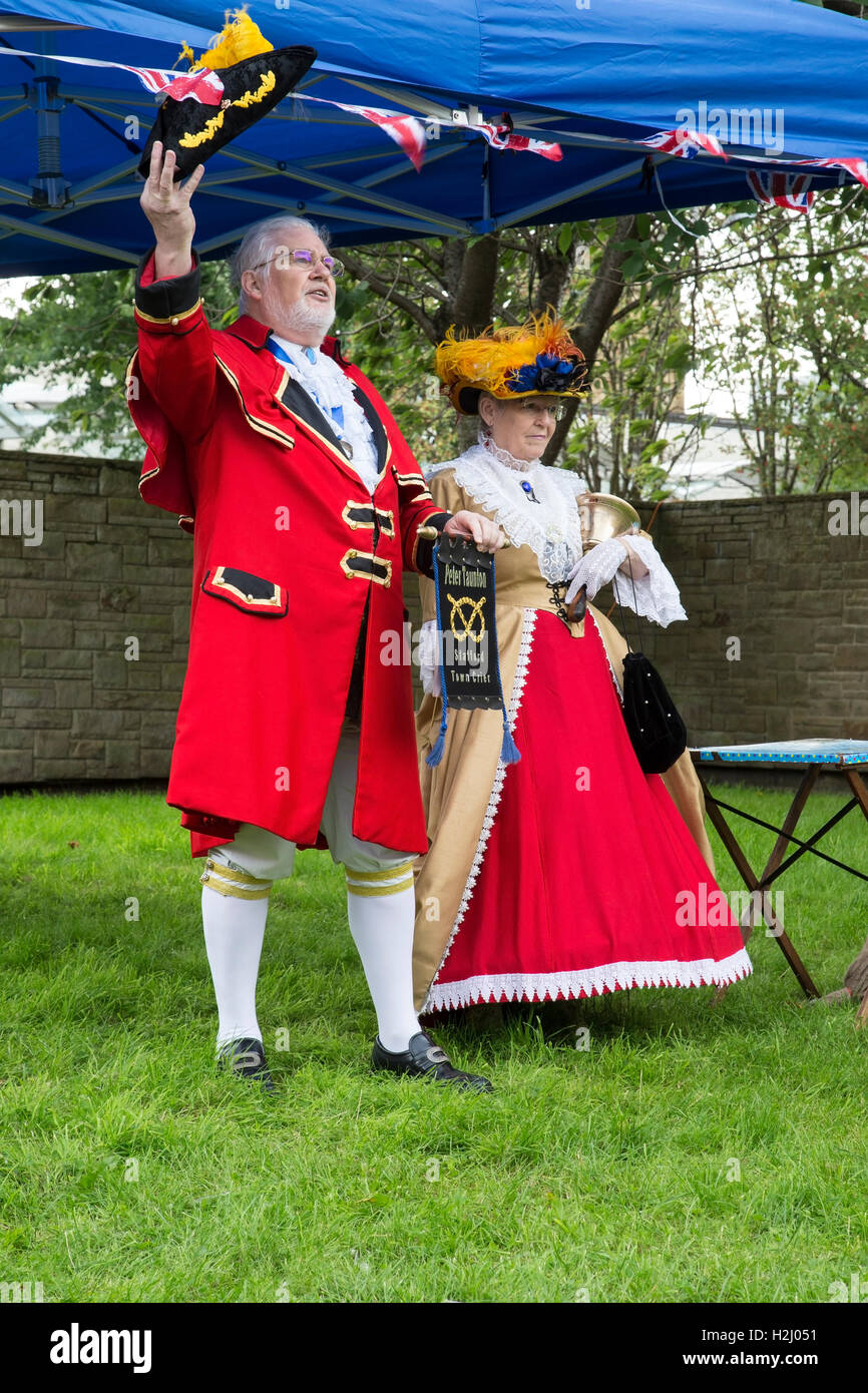 The Stafford Town Crier and his lady making a proclamation at the Huddersfield Town Crier competition 2016 - Stock Image