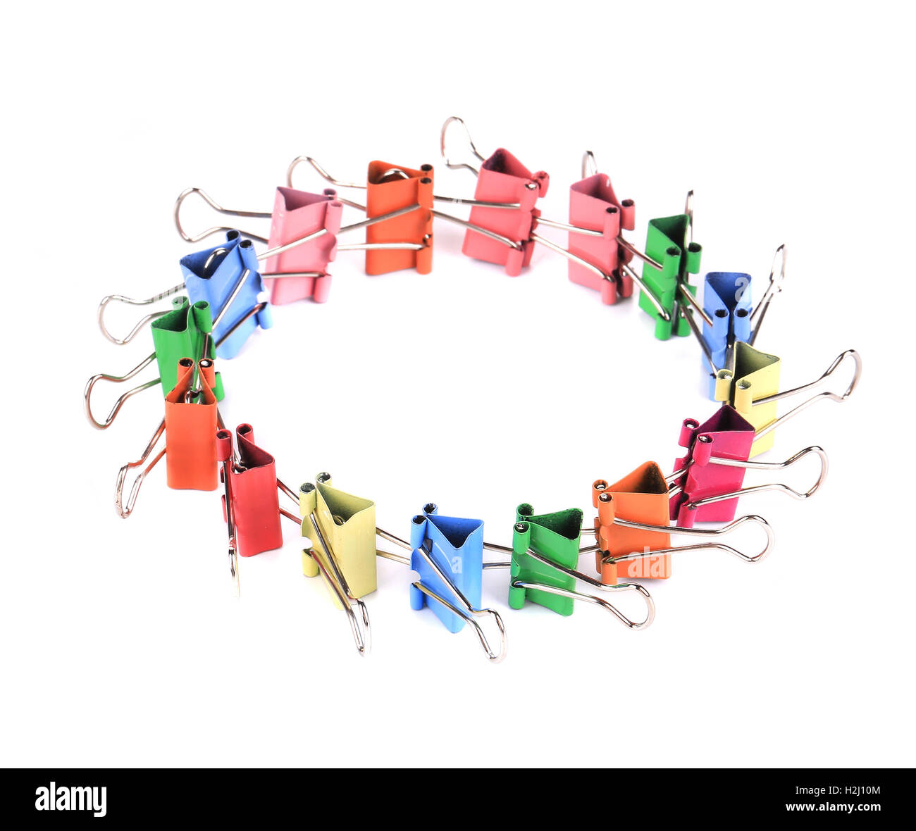 Colourful paper clips arranged into circle. - Stock Image
