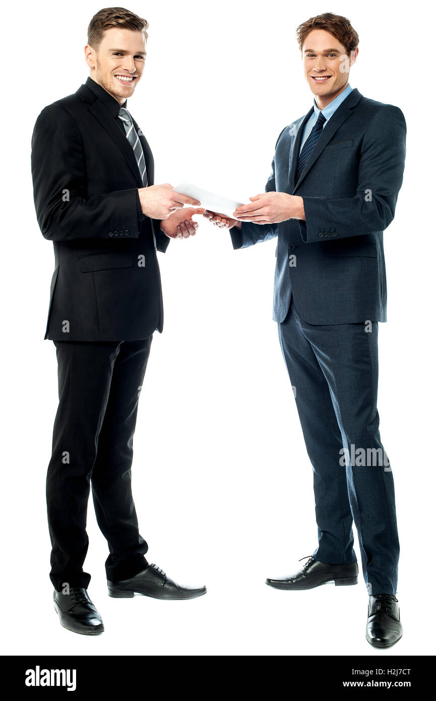 Two businessmen preparing a deal - Stock Image