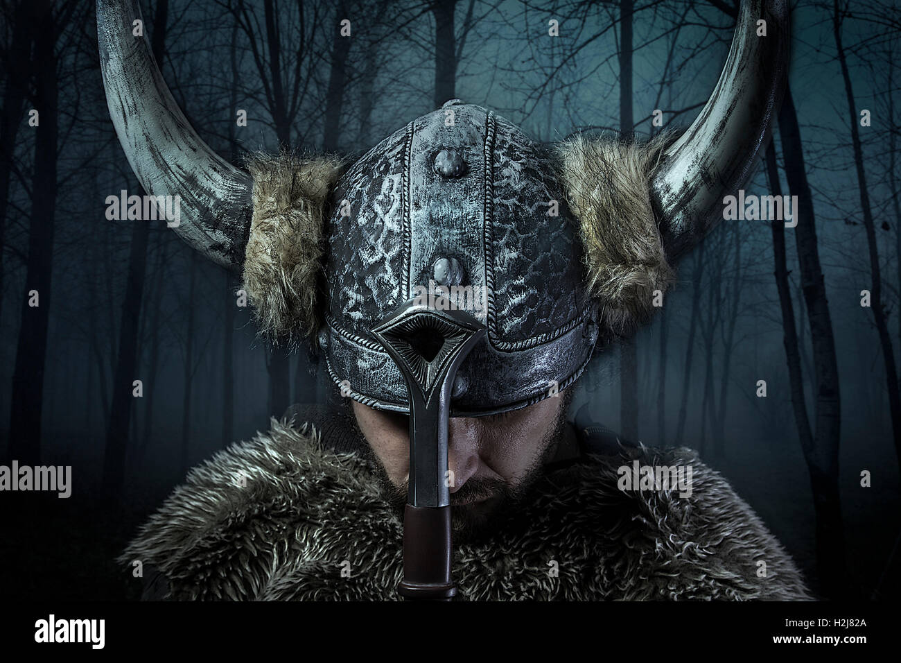 Peace, Viking warrior, male dressed in Barbarian style with swor Stock Photo
