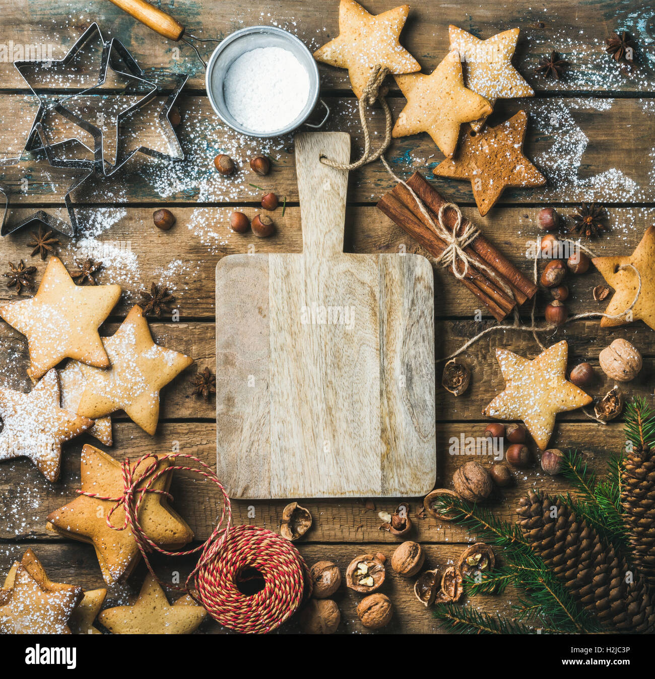 Christmas, New Year background with serving wooden board in center - Stock Image