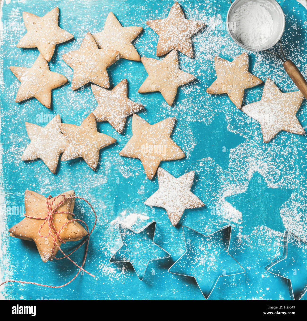 Sweet gingerbread cookies with sugar powder and metal shapes - Stock Image