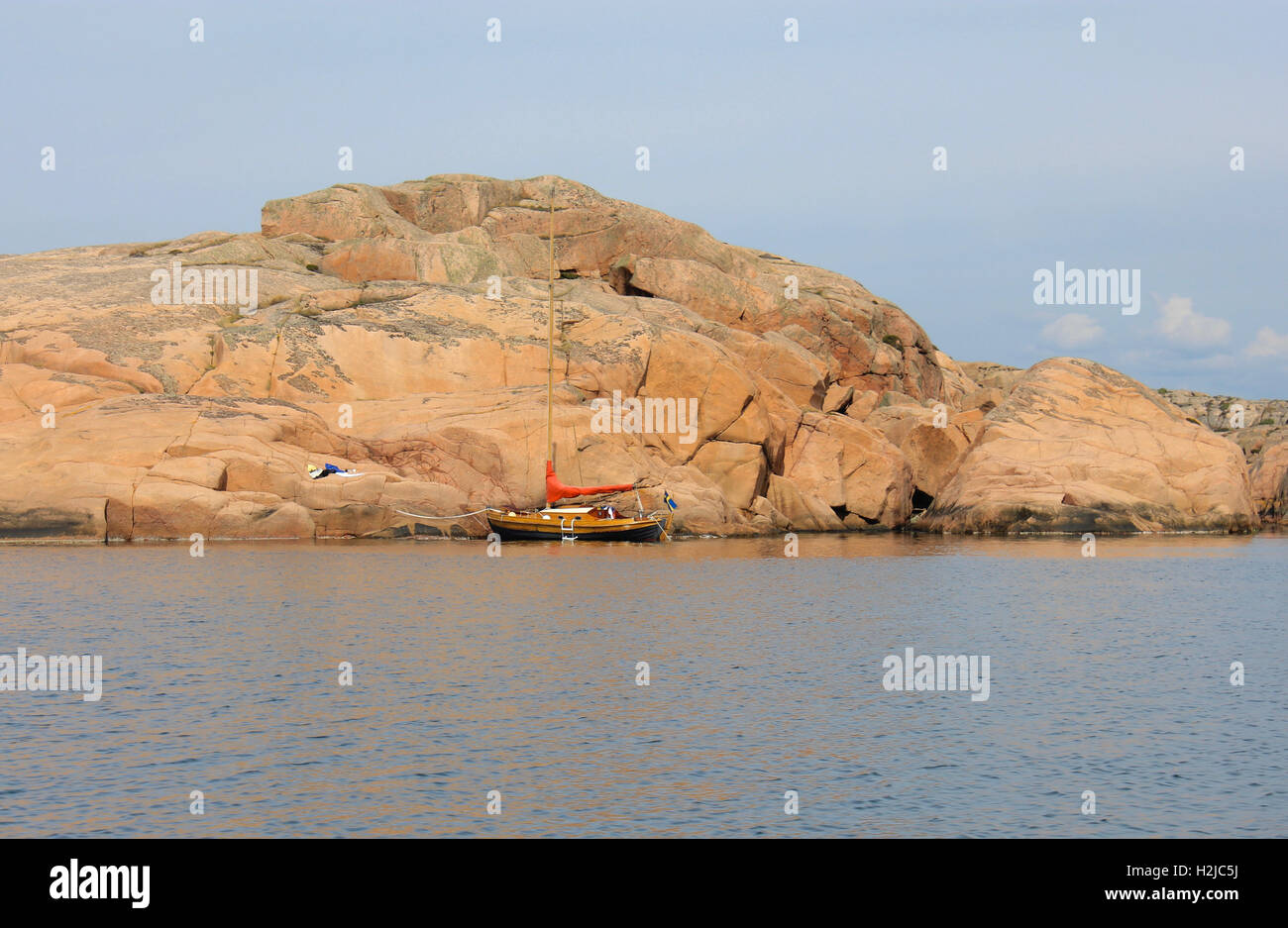 Anchored sailing boat at the coast of Bohuslän Sweden - Stock Image