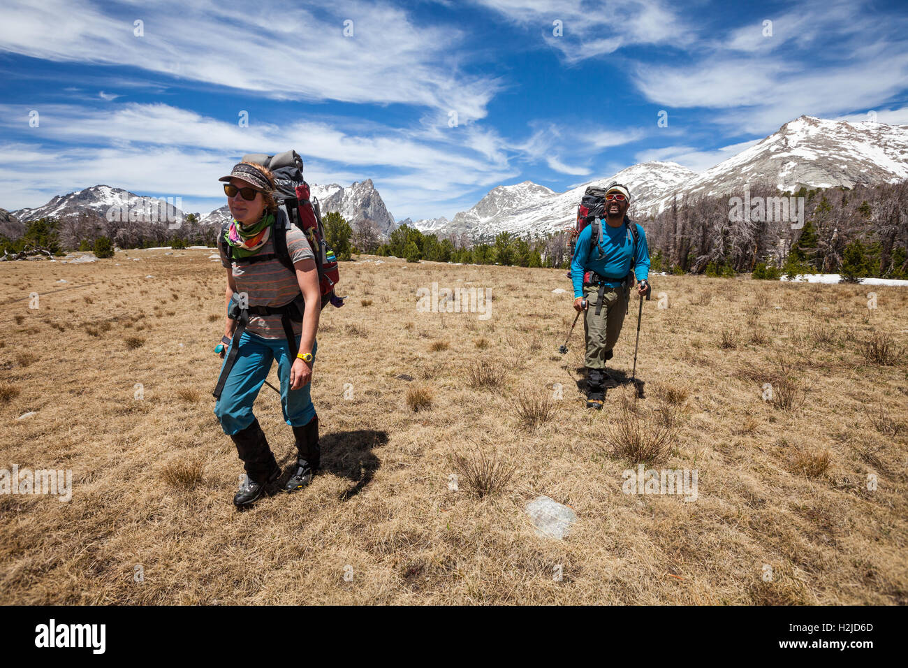 Two people backpacking in the Wind River Mountains of Wyoming, heading towards Temple Pass/Temple Peak - Stock Image