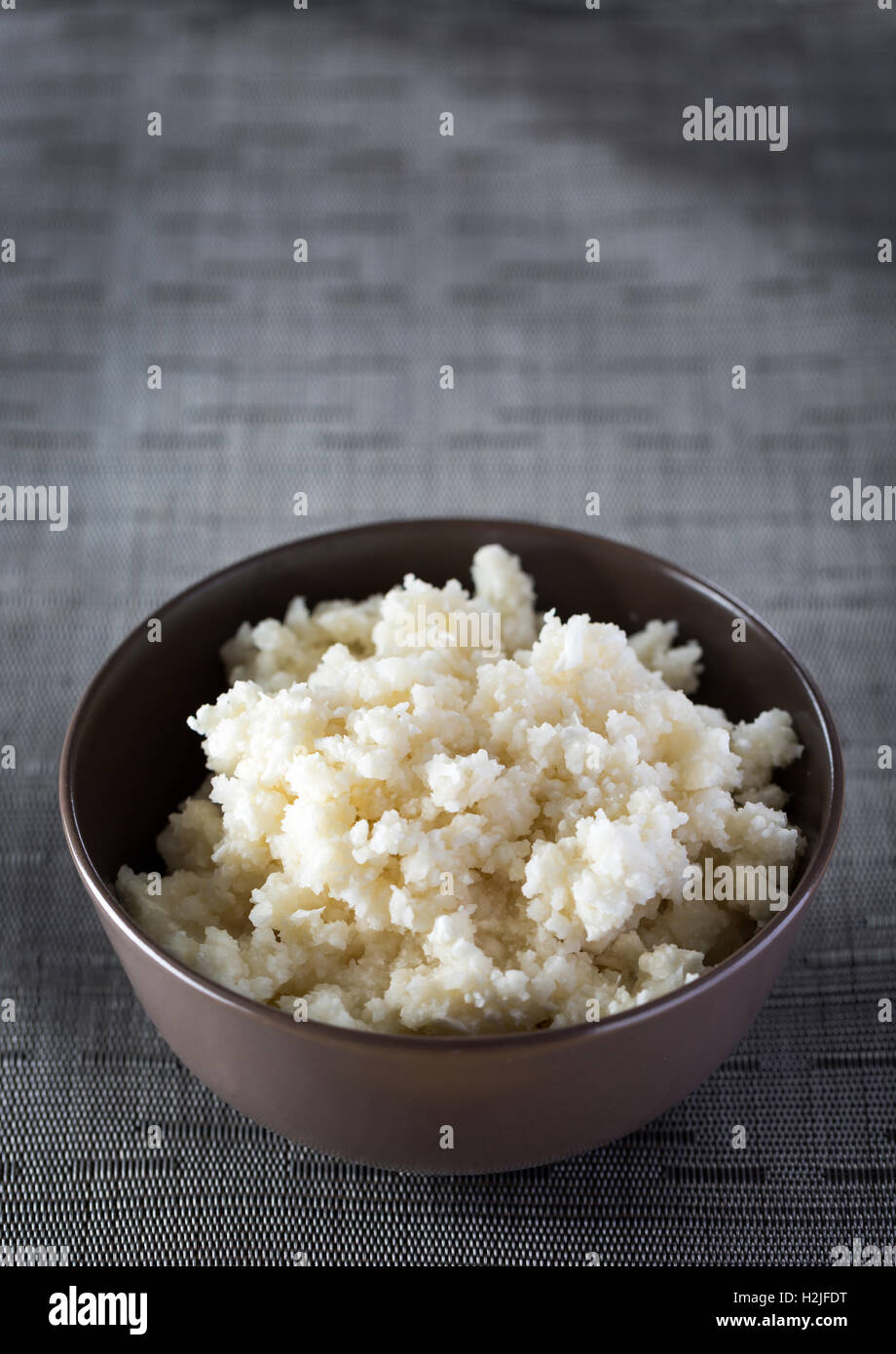 A bowl of cauliflower rice - Stock Image