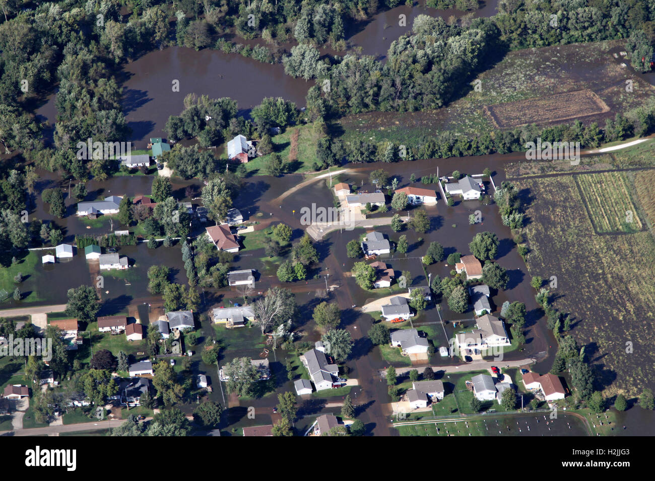 Aerial view of homes overwhelmed by flood waters from the Cedar River across regions of northeast Iowa September - Stock Image