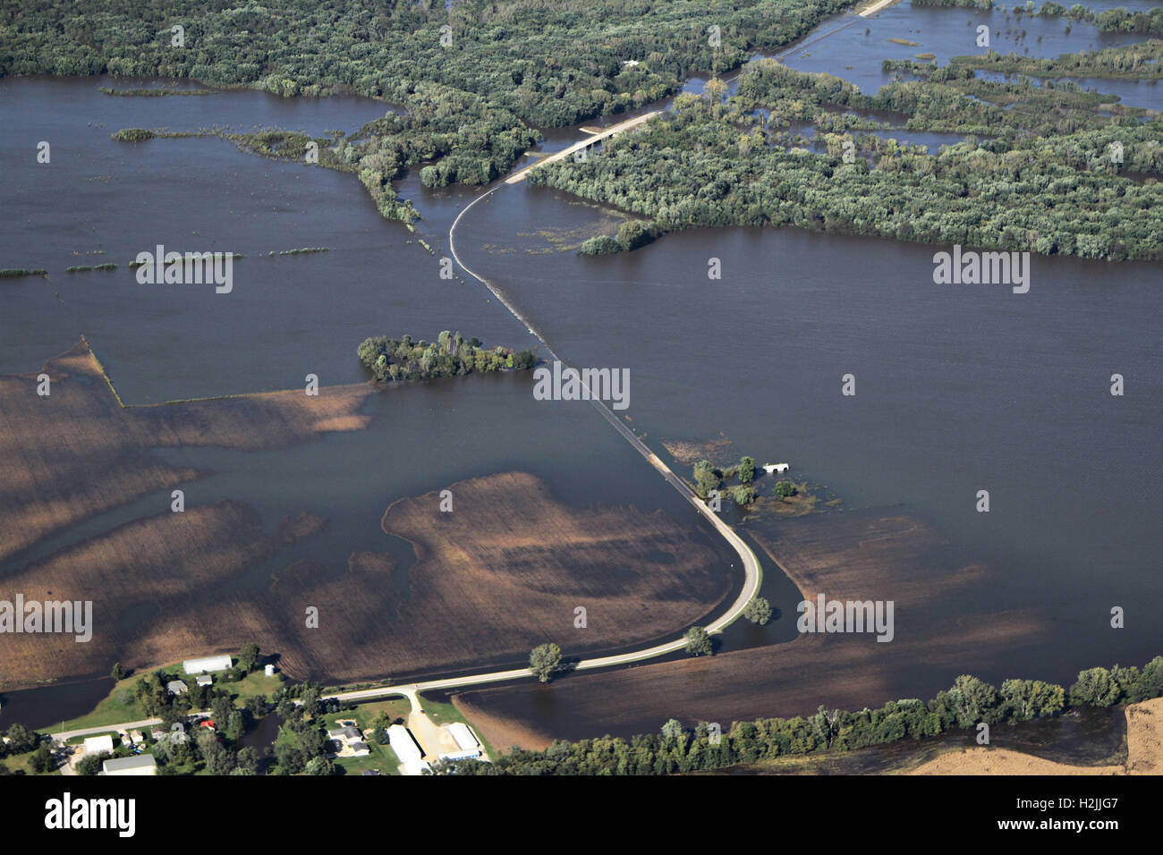 Aerial view of homes and roads overwhelmed by flood waters from the Cedar River across regions of northeast Iowa - Stock Image