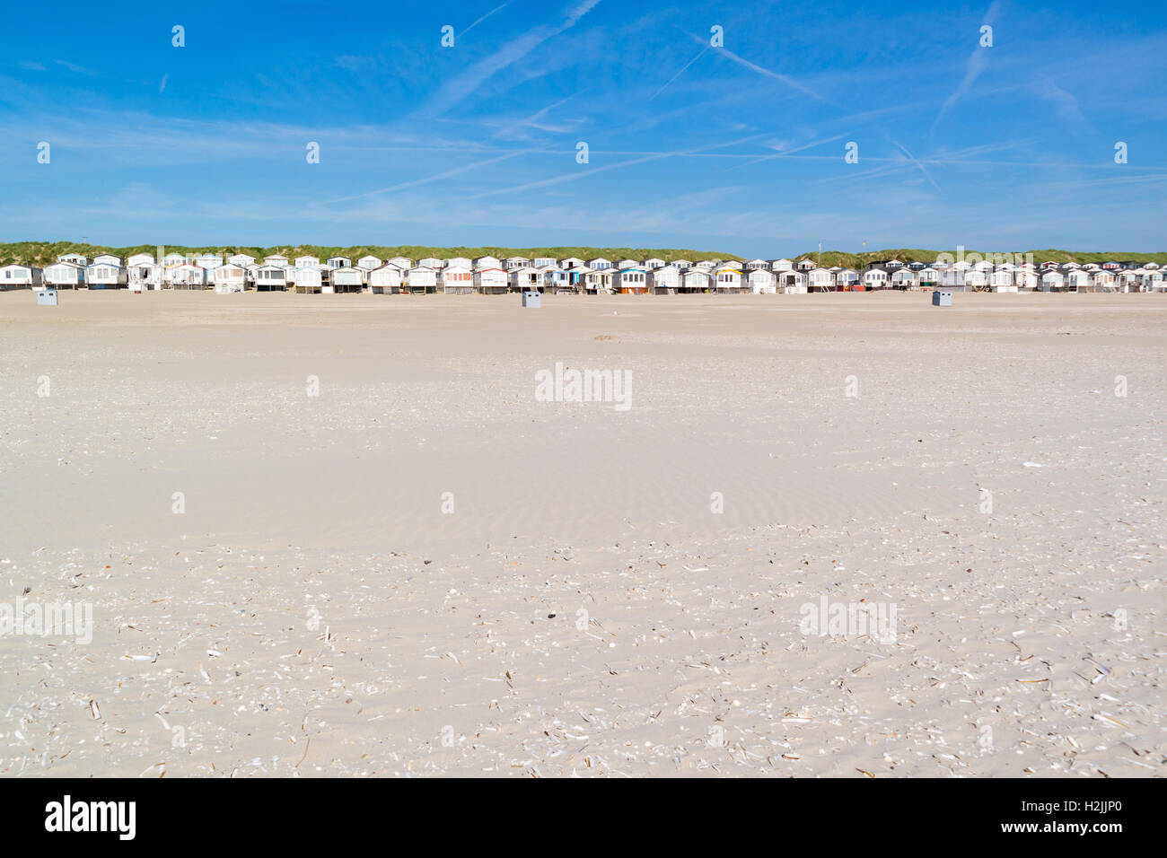 Row of beach houses or huts on IJmuiden beach at North Sea coast in Netherlands - Stock Image