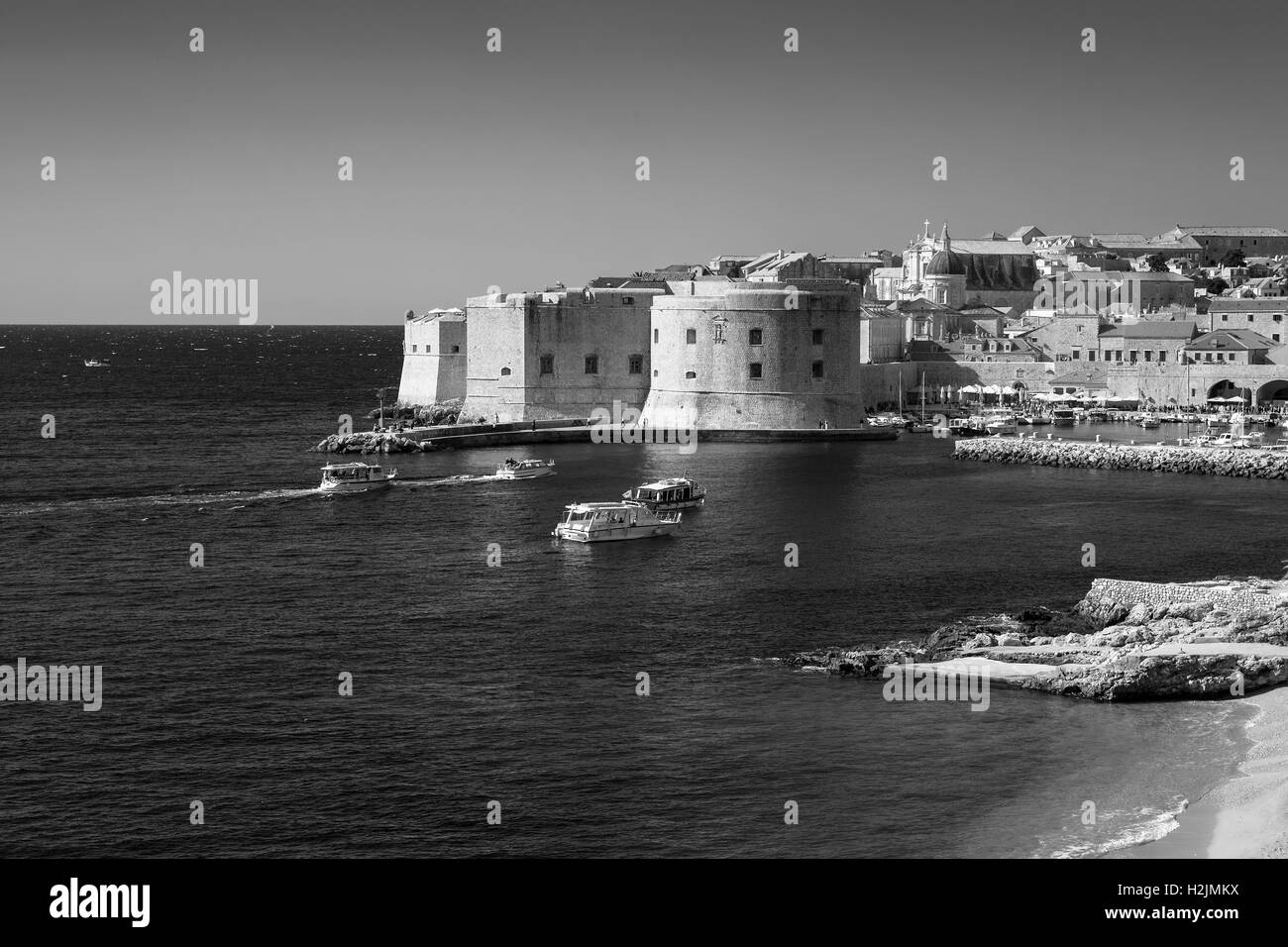 Stari grad (old town) and the old harbour, from Ulica Frana Supila above Banje Beach, Dubrovnik, Croatia, Black - Stock Image