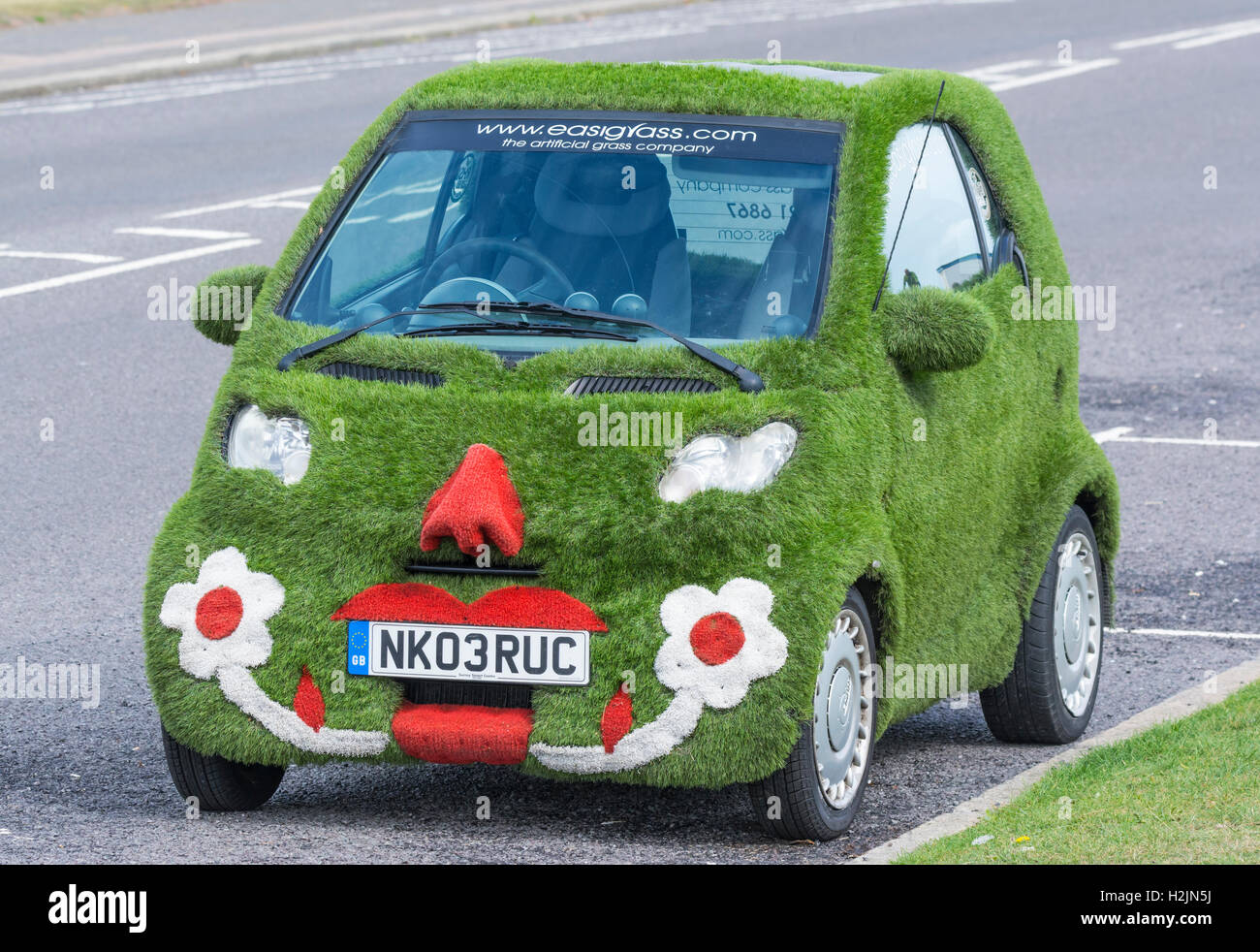 Unique Easigrass Easibug smartcar parked on a road. - Stock Image