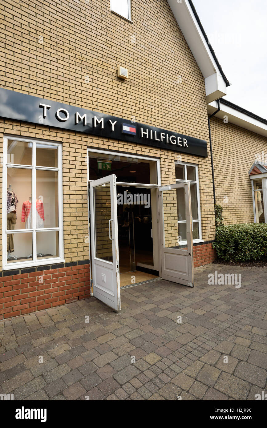 Popular American fashion brand Tommy Hilfiger storefront in the large shopping centre of Freeport in Braintree Essex - Stock Image