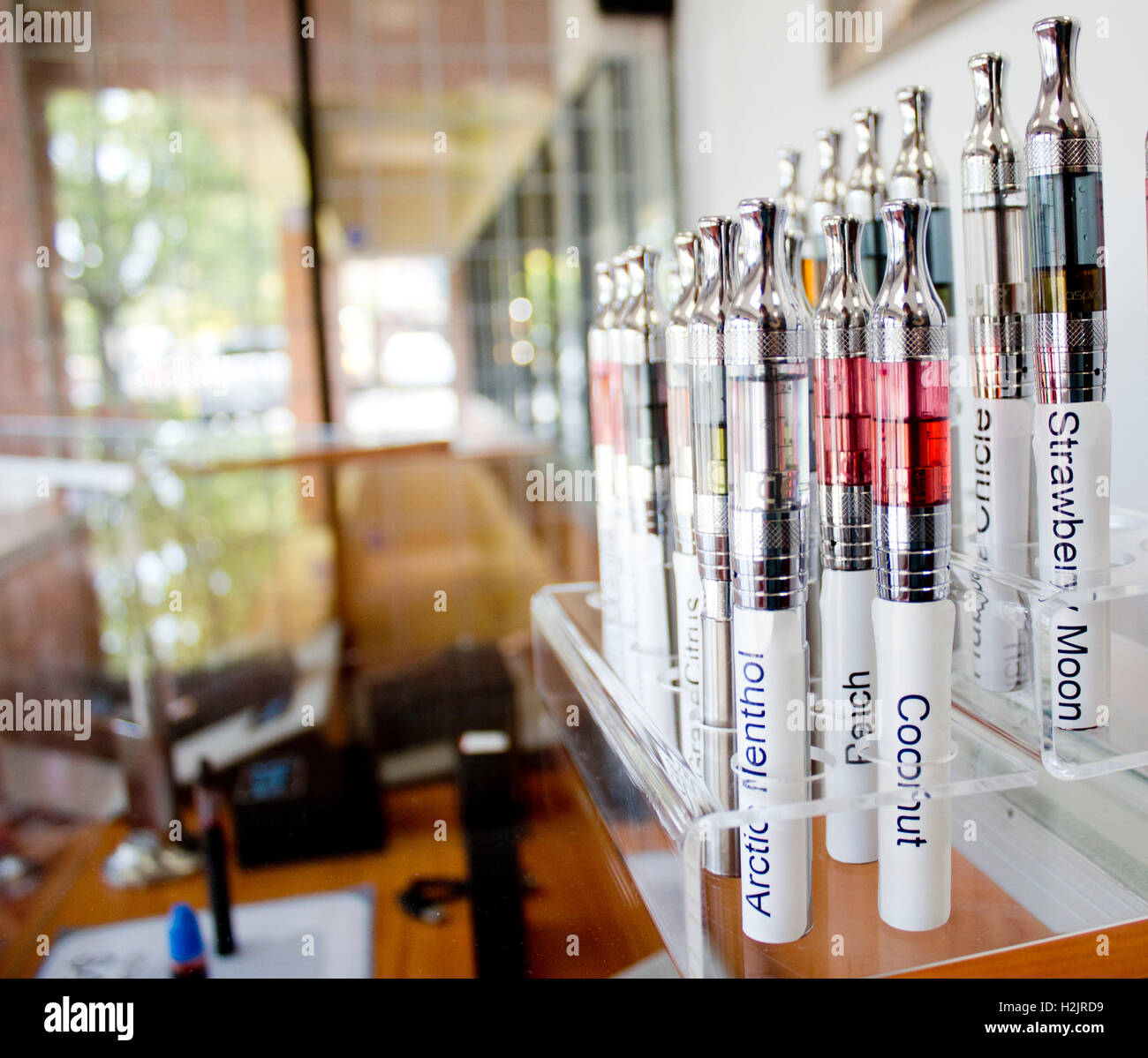E-Juice flavors for sample in a vapor store in electronic cigarette store. - Stock Image