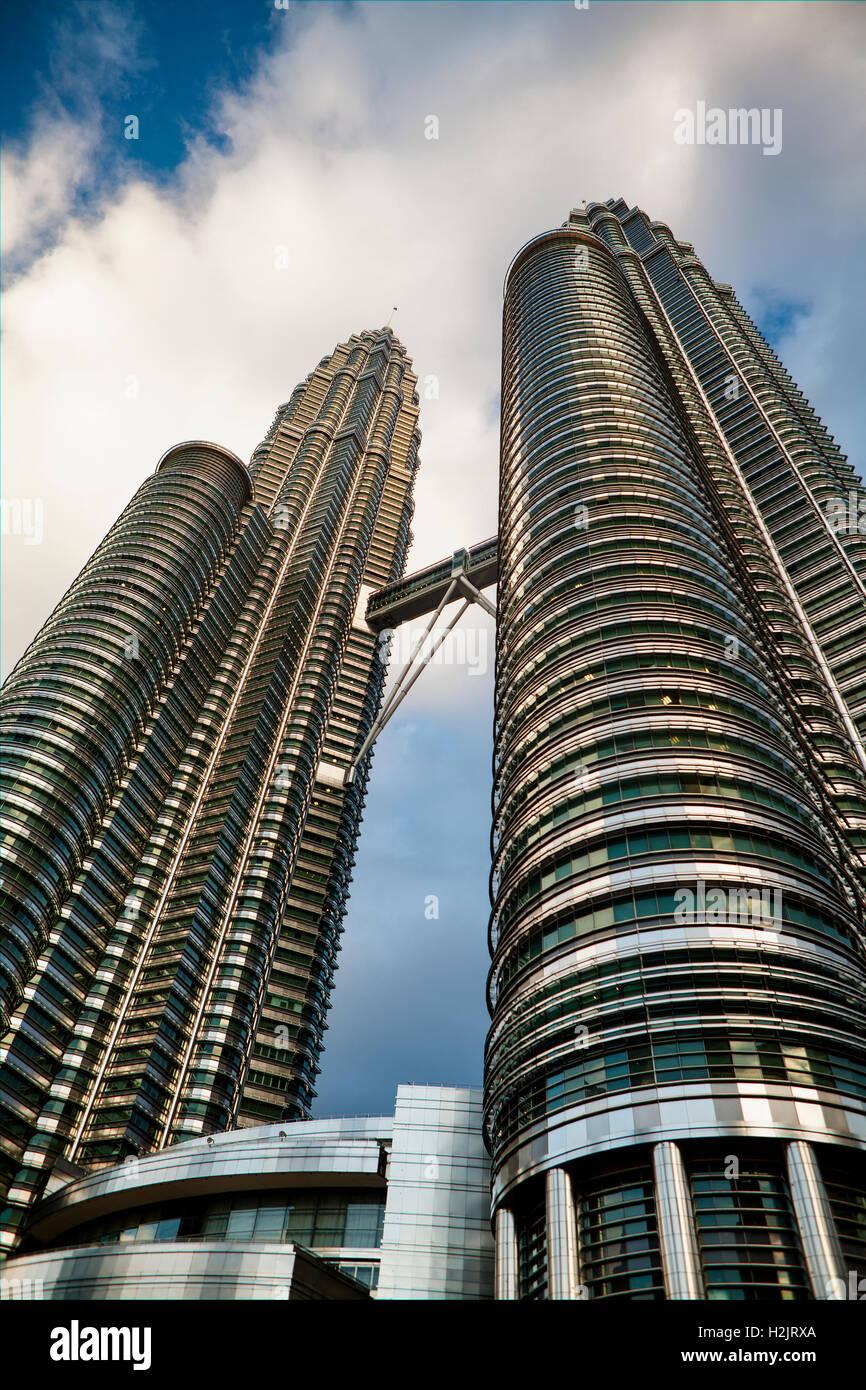Upward angle of Petronas Twin Towers and Skybridge Observation Deck in Kuala Lumpur, Malaysia. - Stock Image