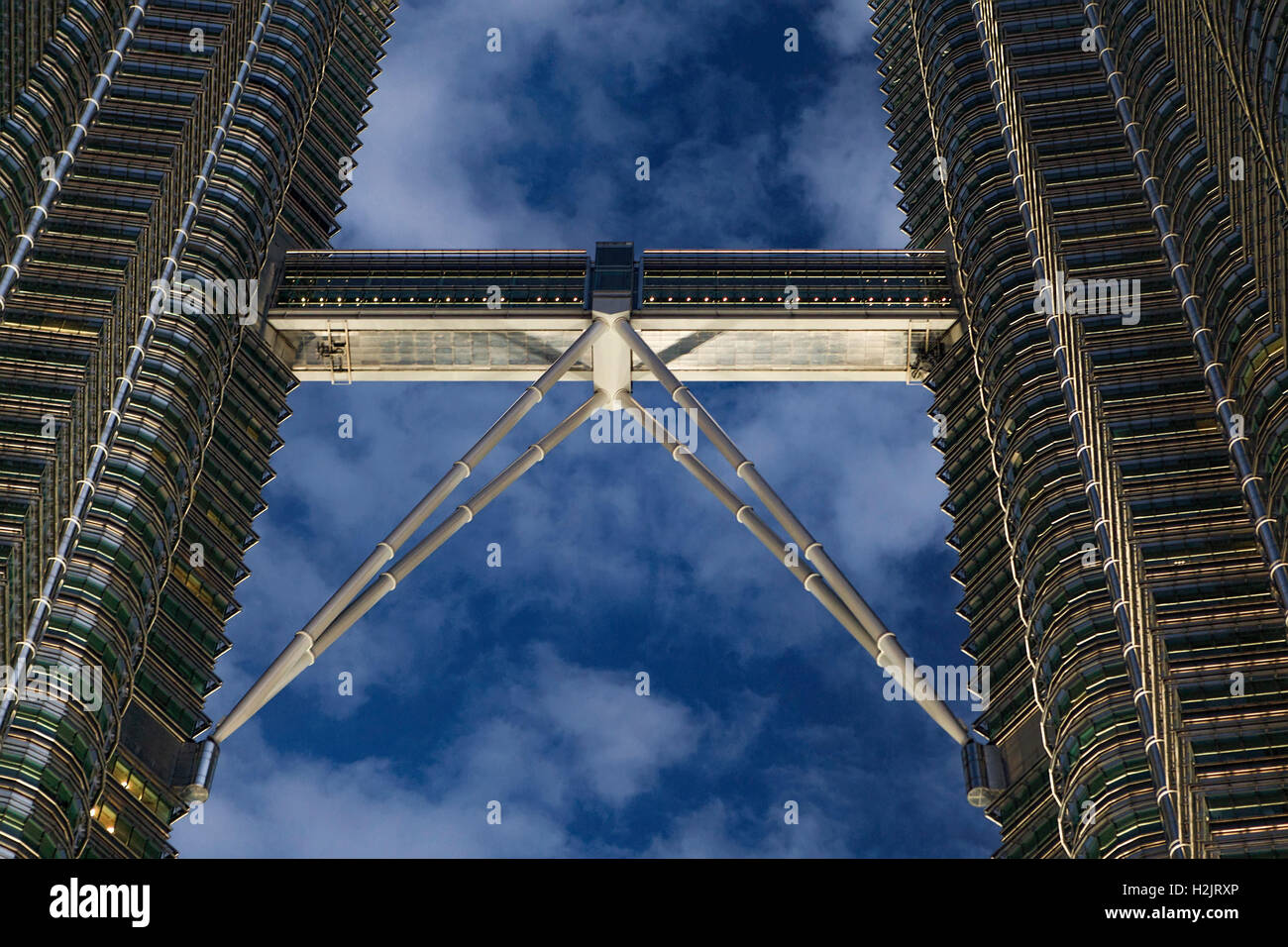 Skybridge of the Petronas Twin Towers at dusk in Kuala Lumpur, Malaysia, Southeast Asia. - Stock Image