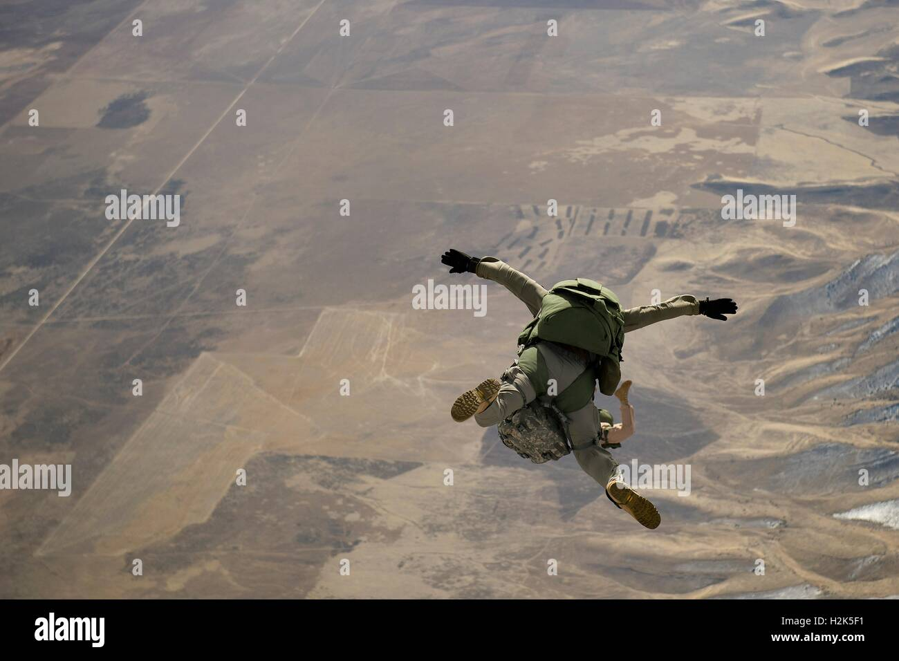 U.S. Army special operation soldiers free fall during a HALO parachute training jump February 22, 2012 near Fairfield, - Stock Image