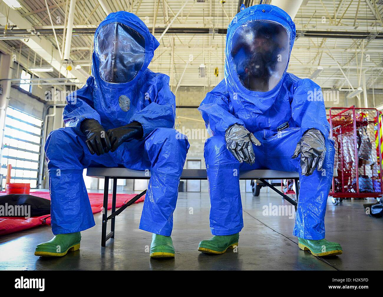 U.S. Air Force soldiers wear protective hazmat clothing in preparation for hazardous material decontamination training - Stock Image