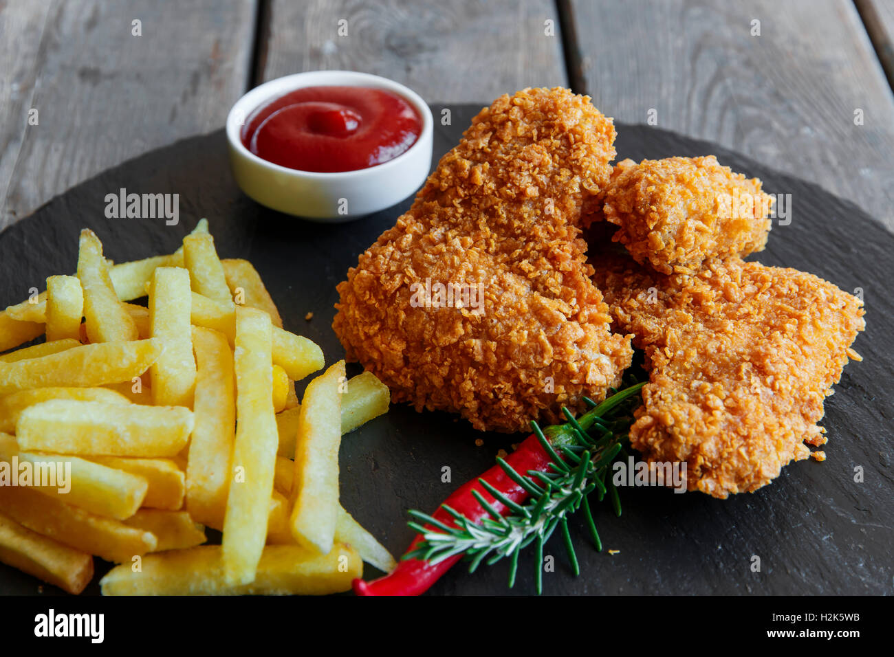 Breaded crispy chicken wing fried french fries sauce - Stock Image