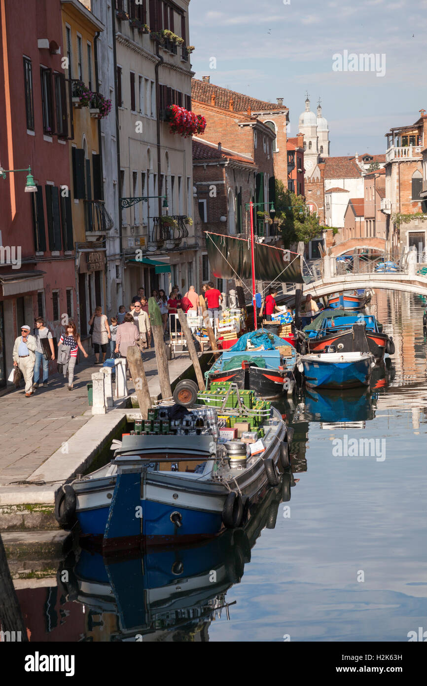 In the early morning, the lively Gherardini street (fondamenta) by the quay of the St Barnabe rio - at Dorsoduro - Stock Image