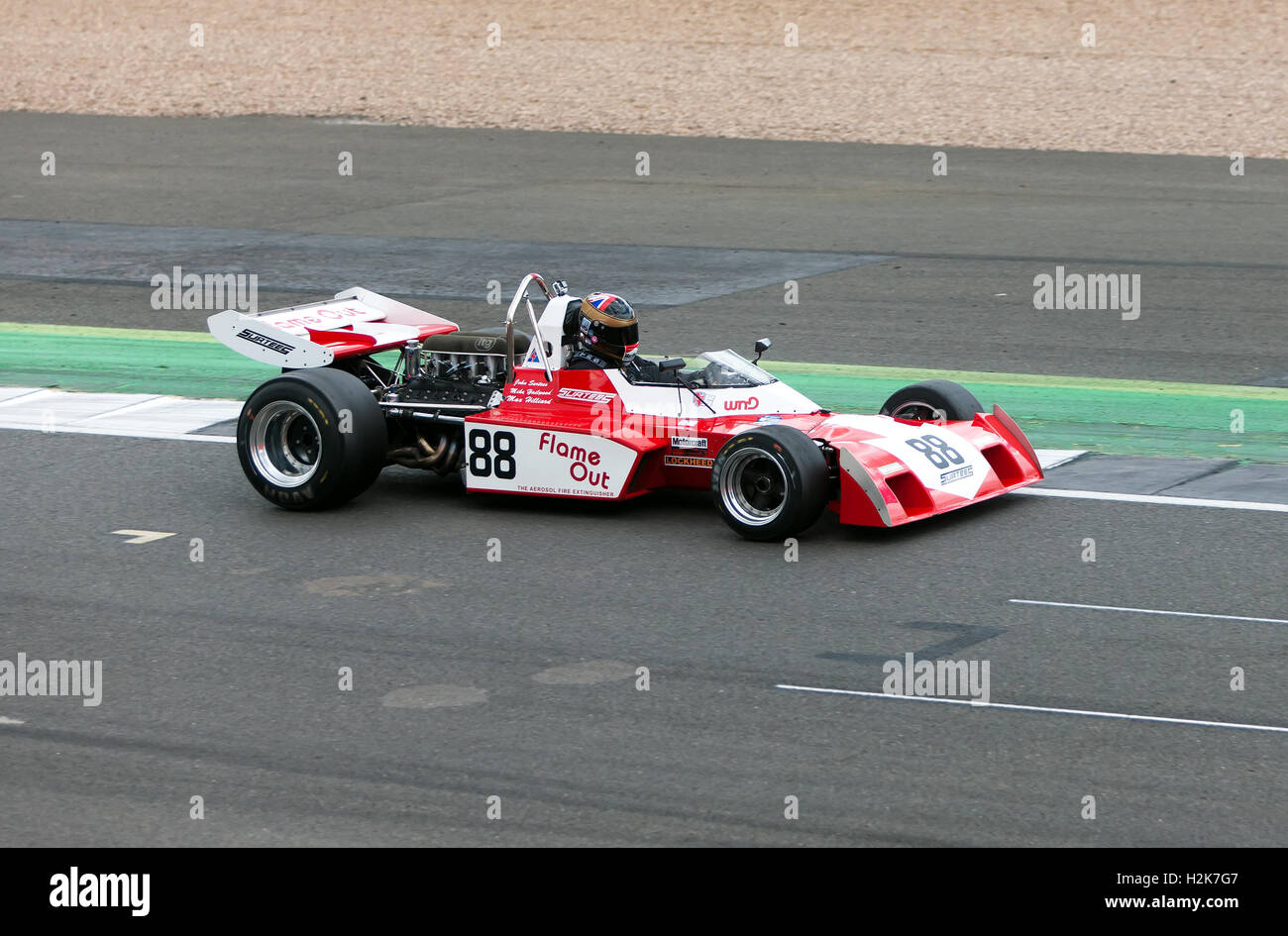 A  Surtees TS9 formula One Race Car being demonstrated at the Silverstone Classic 2016 - Stock Image