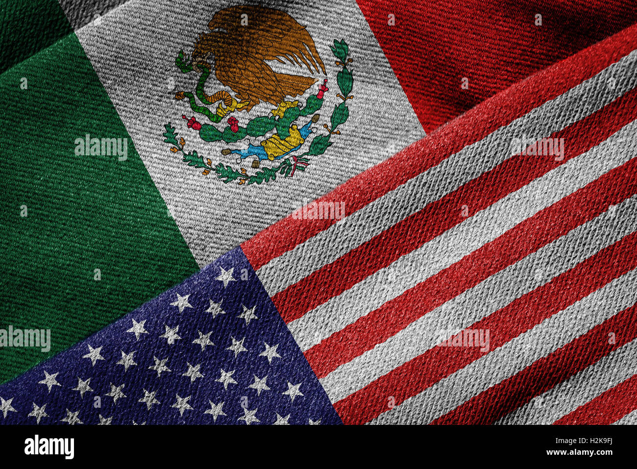 3D rendering of the flags of USA and Mexico on woven fabric texture. Detailed textile pattern and grunge theme. Stock Photo