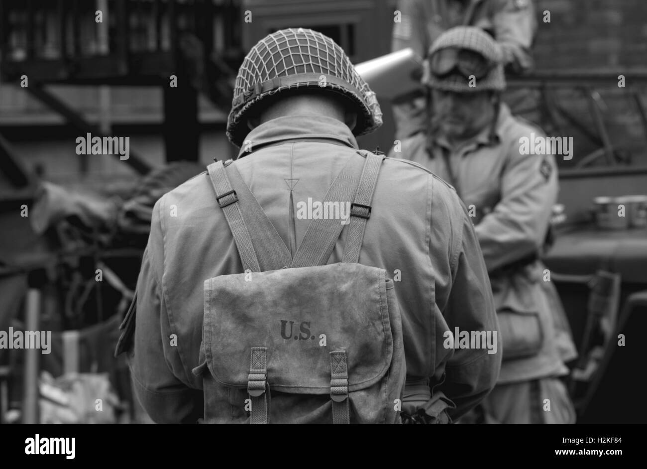 black and white soilders in us uniform heads tilted - Stock Image