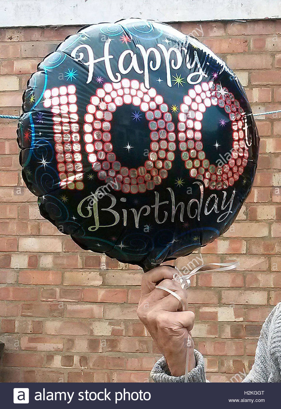 File Photo Dated 07 08 15 Of Someone Holding A Happy 100th Birthday Balloon As The Number Congratulatory Messages Sent By Queen To People Reaching