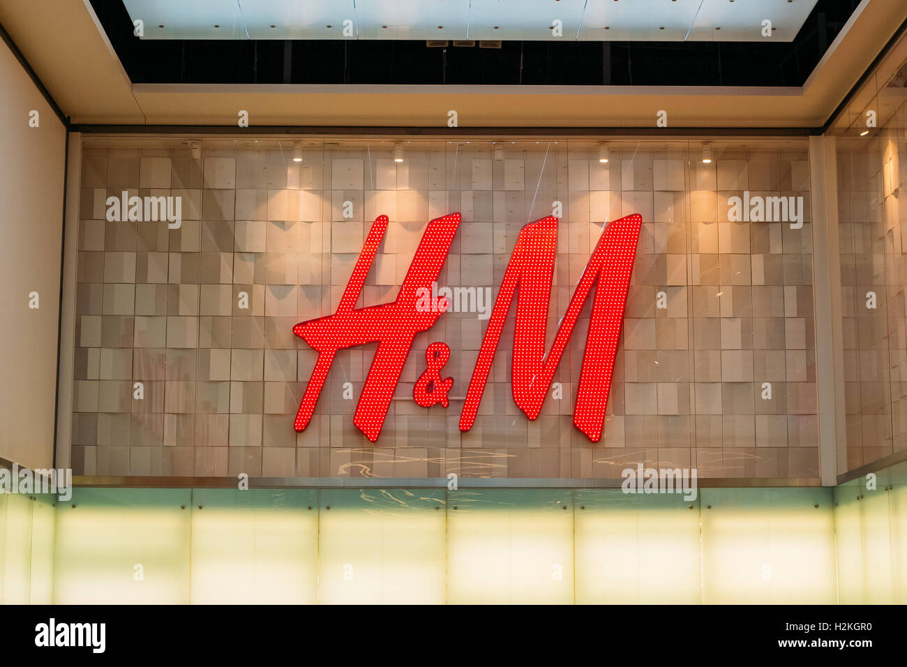 Vilnius, Lithuania - July 08, 2016: Close The Illuminated Red Logotype H&M Of Hennes & Mauritz Brand At - Stock Image
