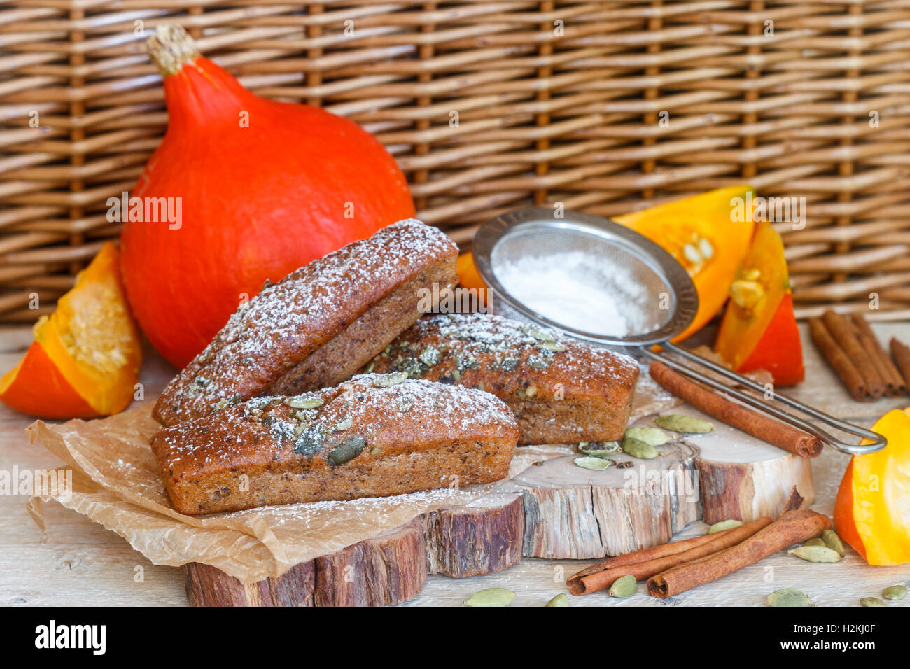 Homemade pumpkin financier cake with cinnamon and cardamom. Autumn spiced cakes. A rustic style. Selective focus - Stock Image