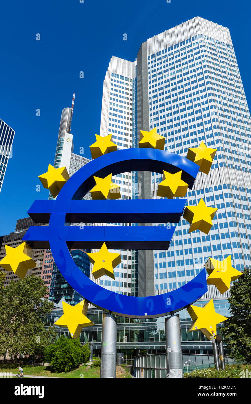 The Euro symbol in front of the Eurotower, Willy-Brandt-Platz, Financial District, Frankfurt, Hesse, Germany - Stock Image