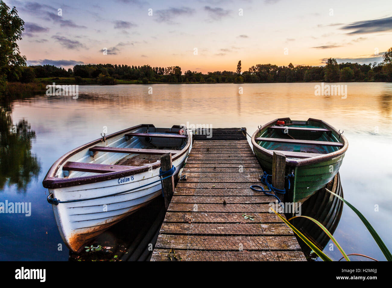 Late summer sunrise on one of the lakes at Cotswold Water Park - Stock Image