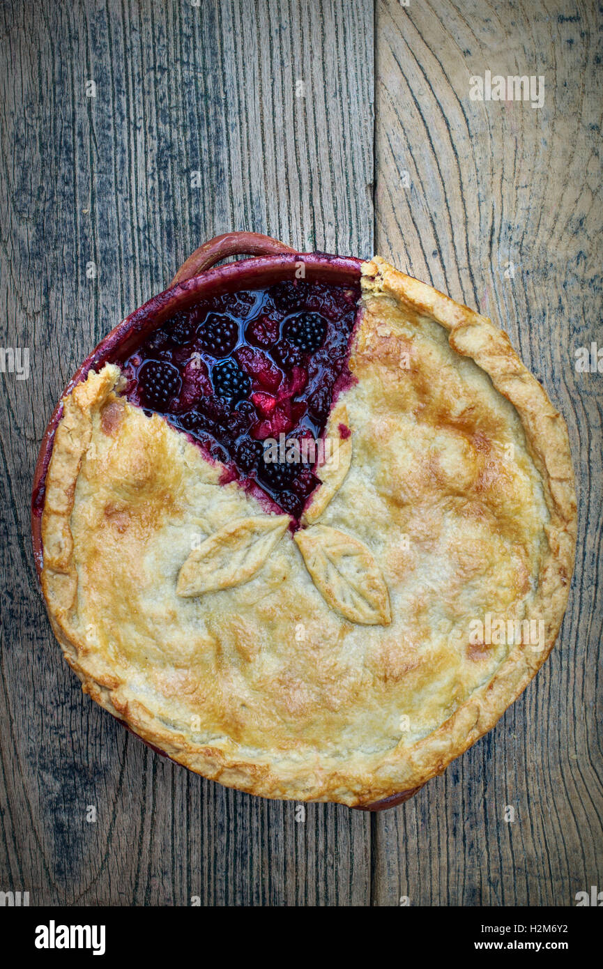 Homemade Blackberry and Apple Pie on wood - Stock Image