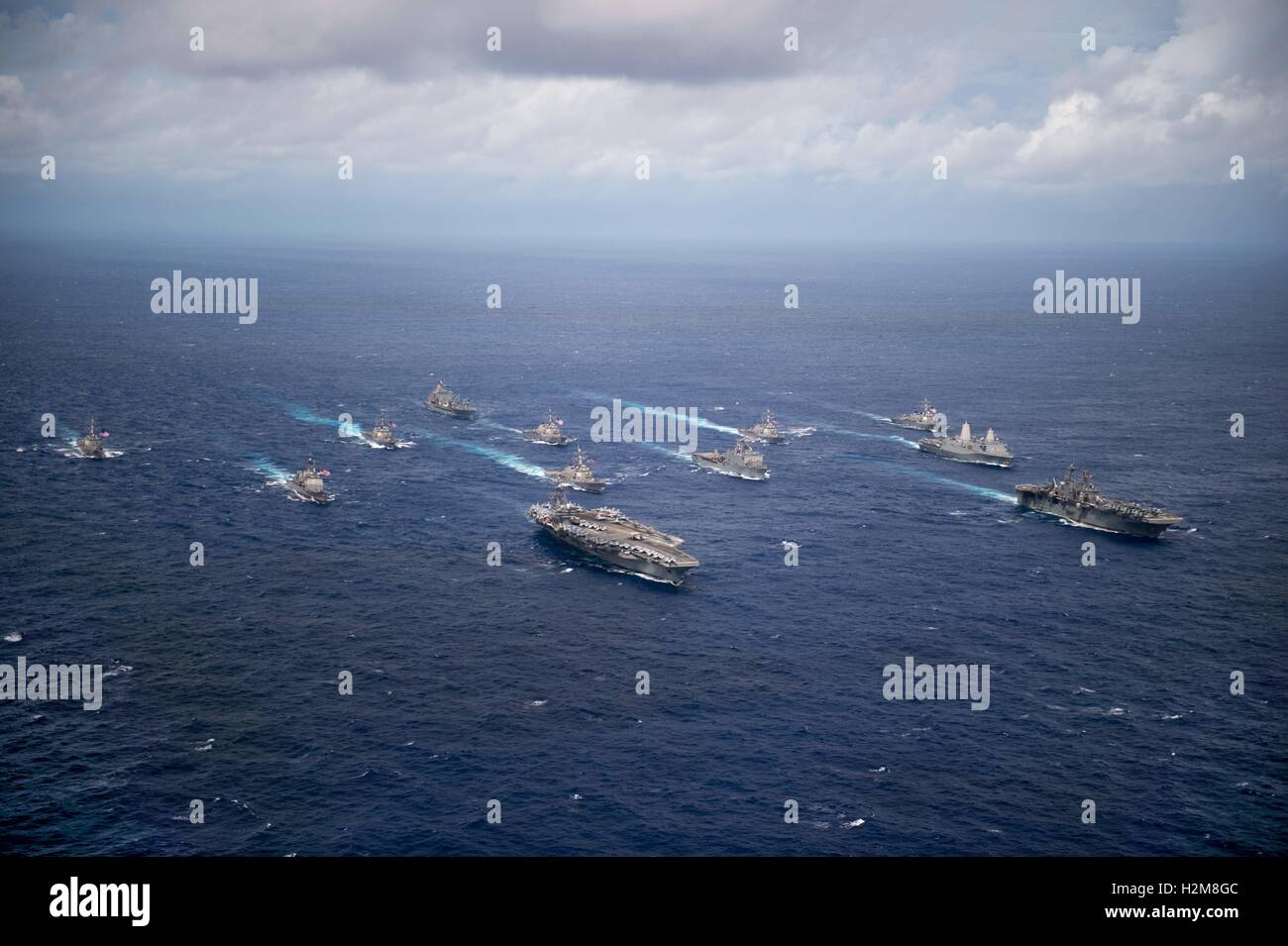 USN ships steam in formation to signify the completion of