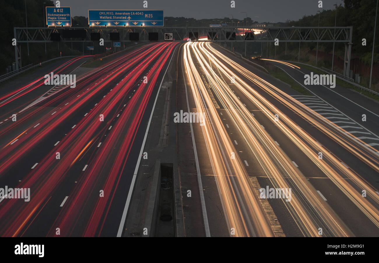 Dusk traffic M25 facing North East Junction 17 - Stock Image