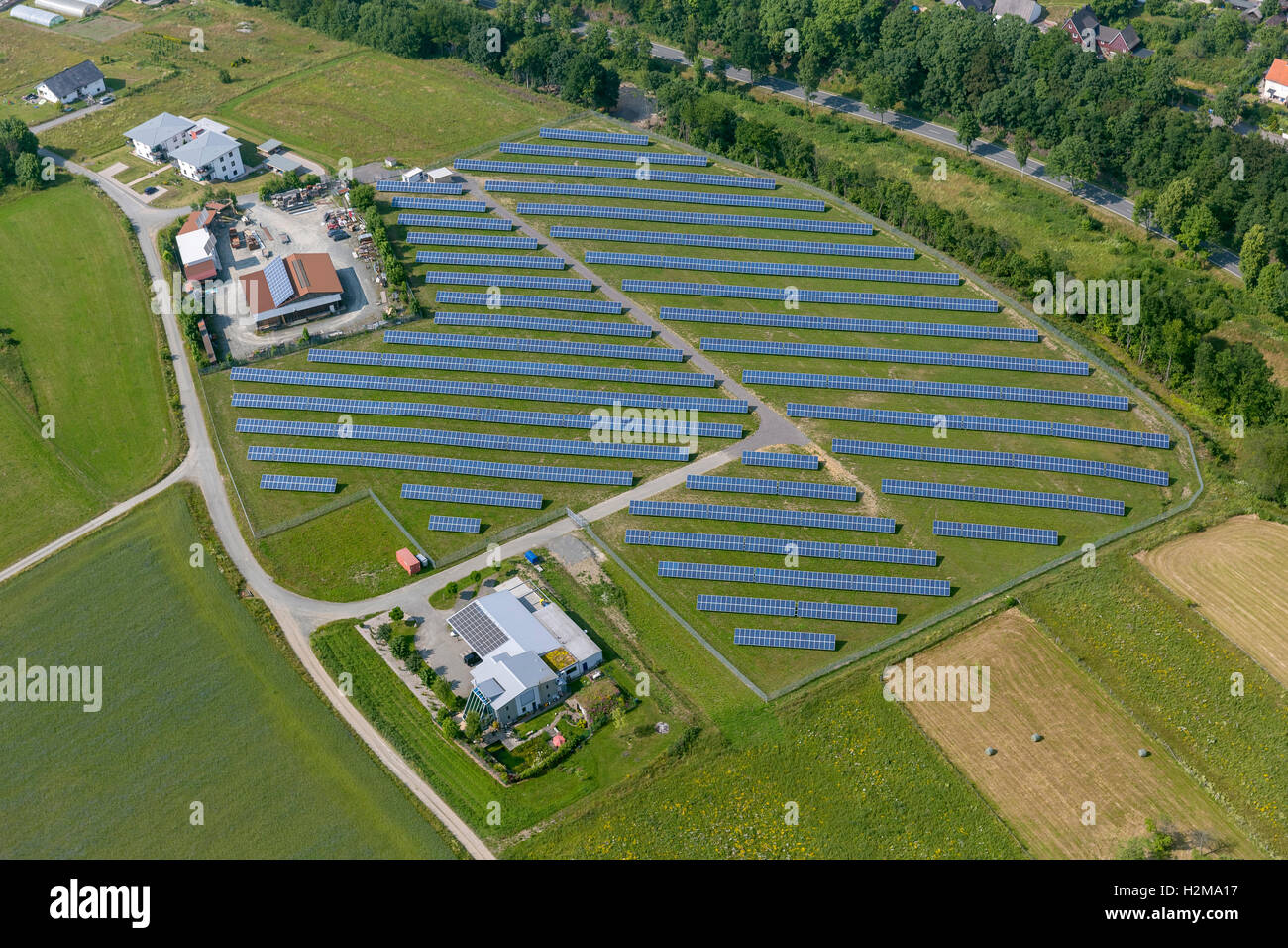 Aerial view, field with solar panels, solar panels, Bromskirchen, Hessen, Germany Europe aerial view birds-eyes - Stock Image