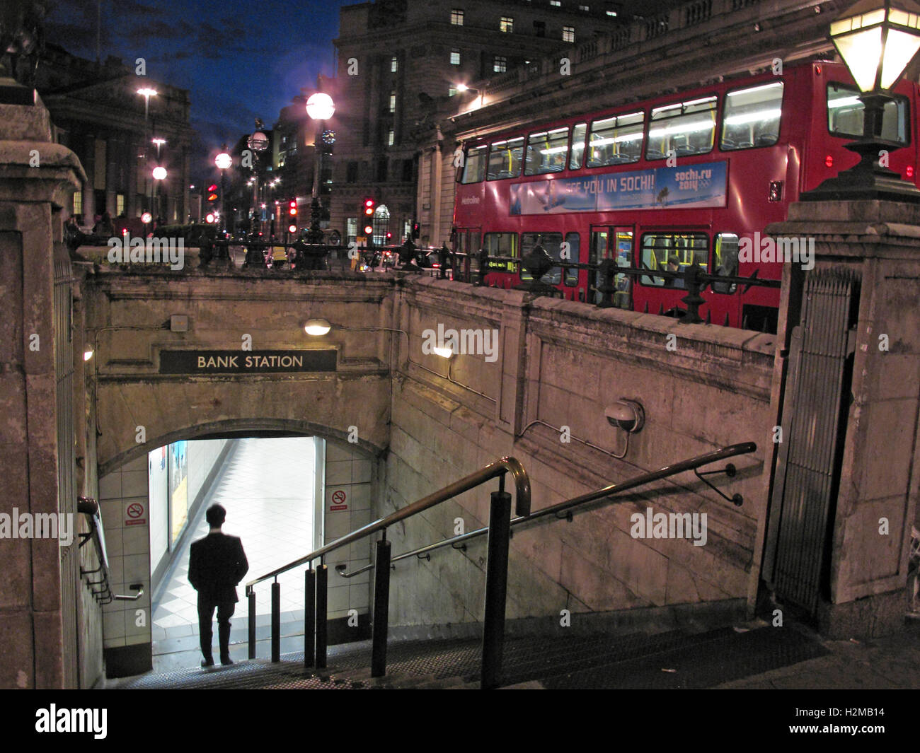 Bank Tube Station and passengers, City Of London, at Dusk - Stock Image