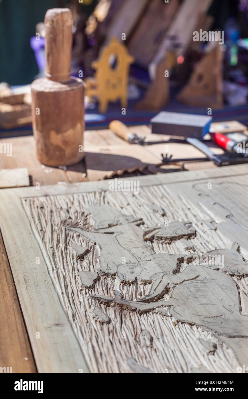 Craftsman table with tools for engrave wooden crafts - Stock Image