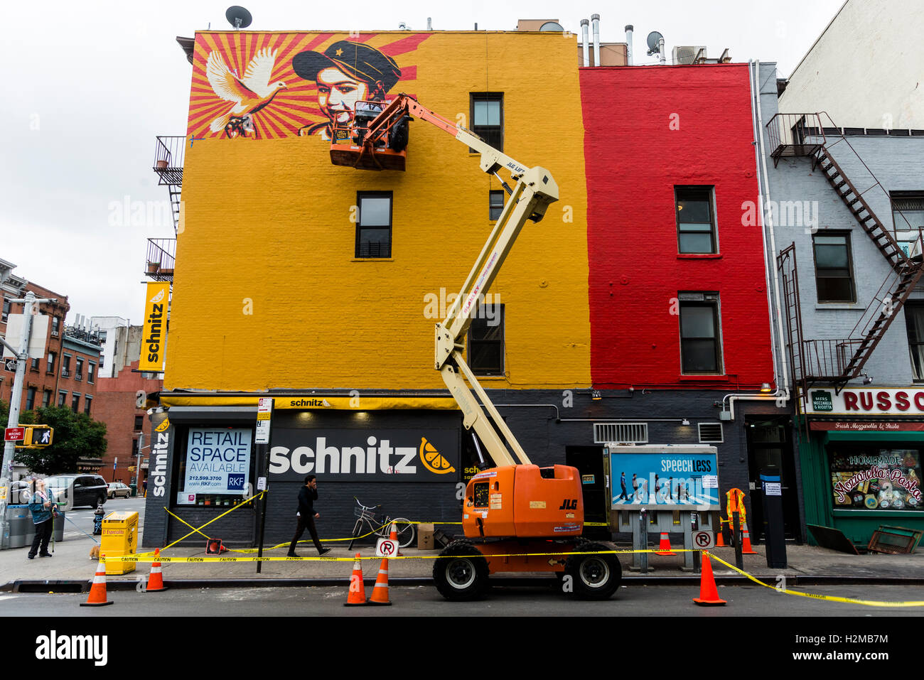New York, NY 28 September 2016 Shepard Fairey mural goes up on the wall of a building in New York City's East - Stock Image