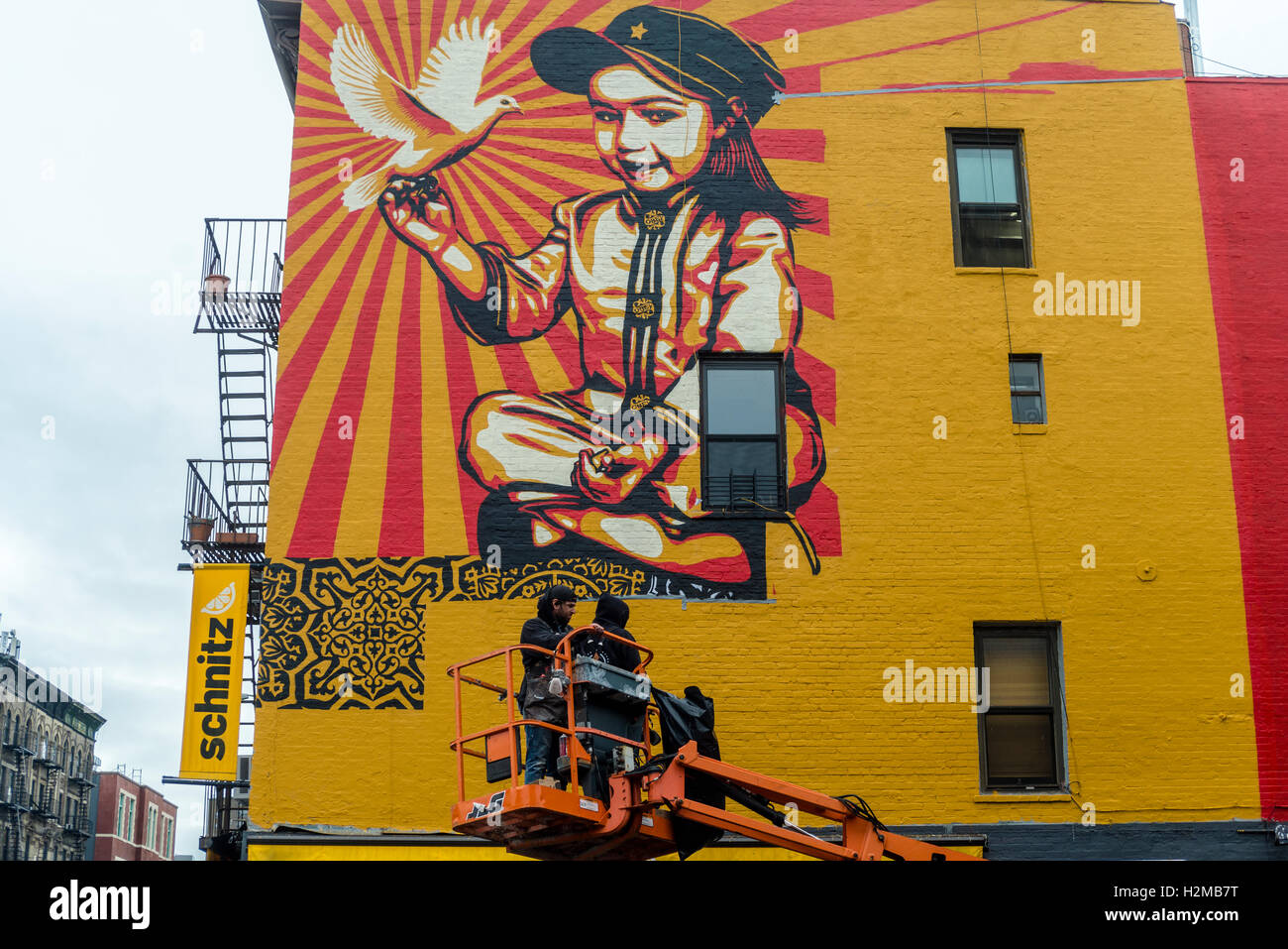 New York, NY 29 September 2016 Shepard Fairey mural goes up on the wall of a building in New York City's East - Stock Image