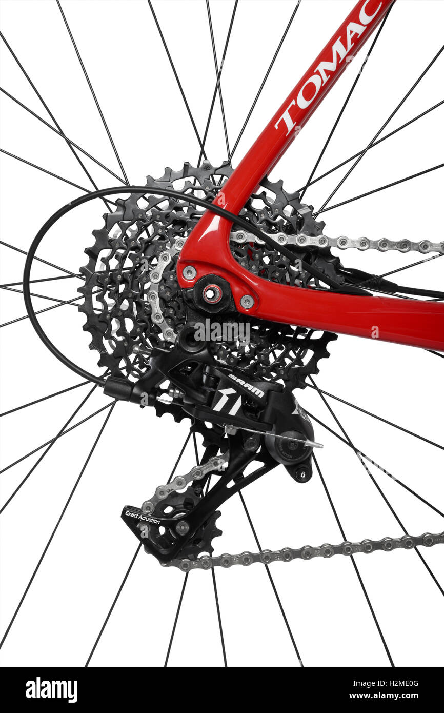 Bicycle rear derailleur, chain and cassette on white background - Stock Image