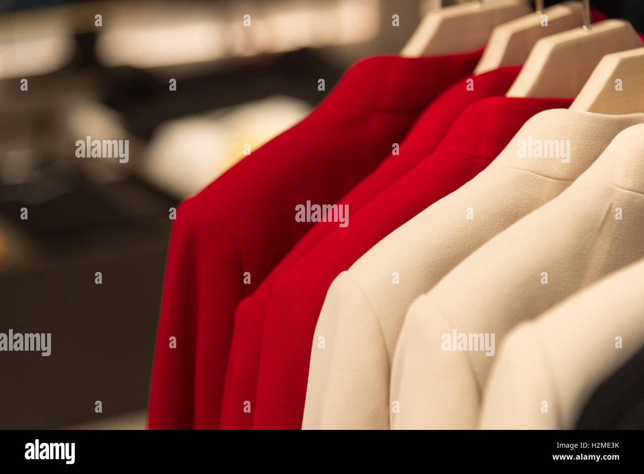 womens cashmere coat on hanger in the store - Stock Image