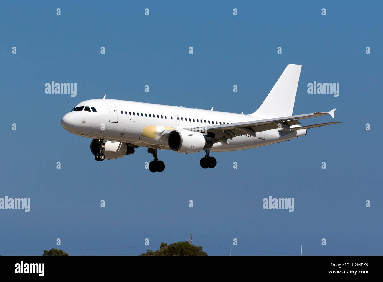 Hyperion Aviation Airbus A319-111 [9H-LCB] arriving runway 31 in all white livery, with some replaced panels in - Stock Image