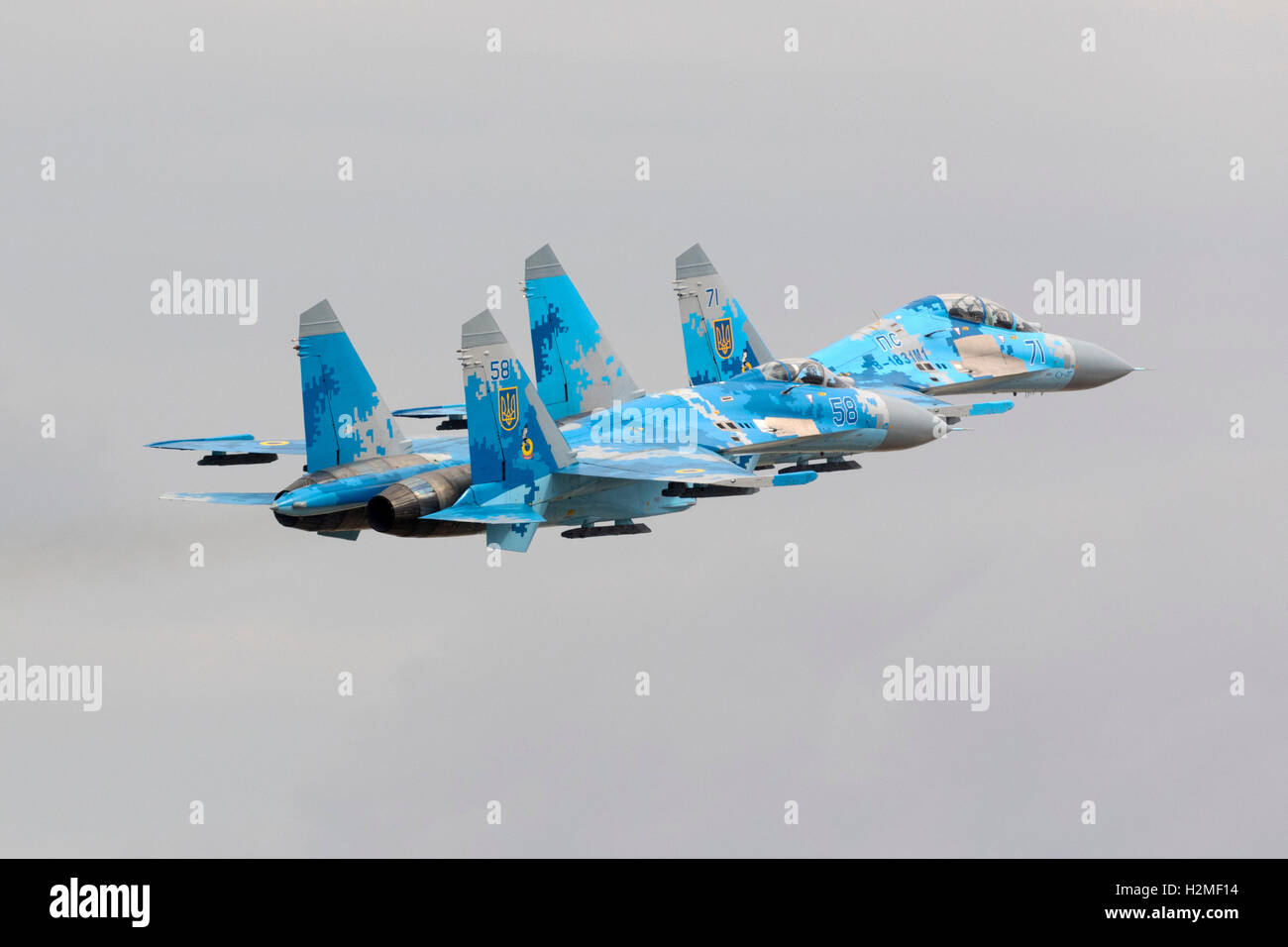 Two Ukrainian Air Force Sukhoi Su-27'departing together after the airshow is over. Stock Photo