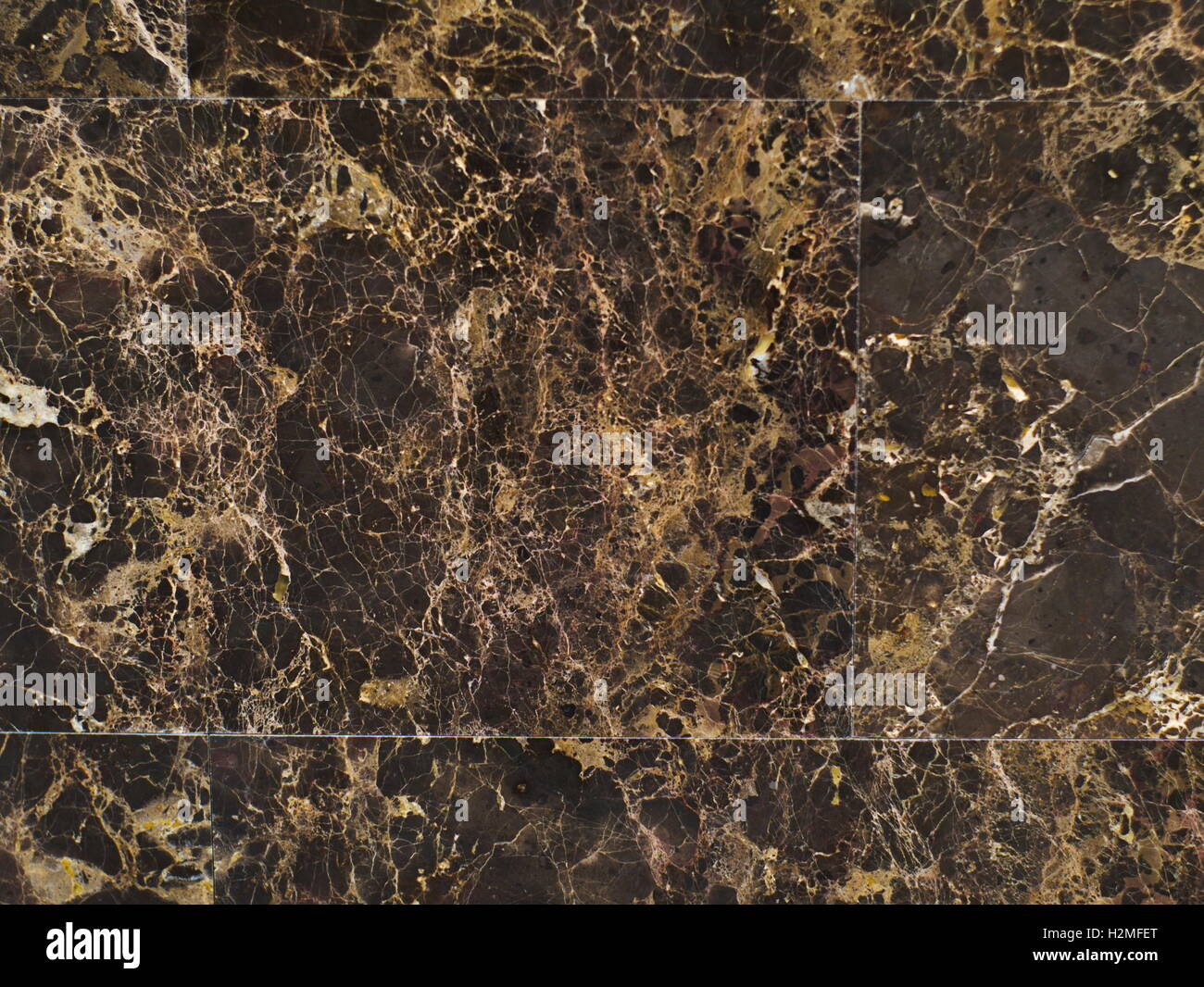 Closeup Shot Of Dark Brown Granite Tile On The Floor