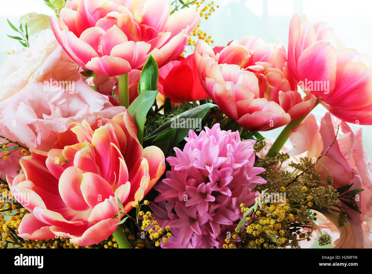 Bouquet of different flowers including tulips and mimosa stock photo bouquet of different flowers including tulips and mimosa izmirmasajfo