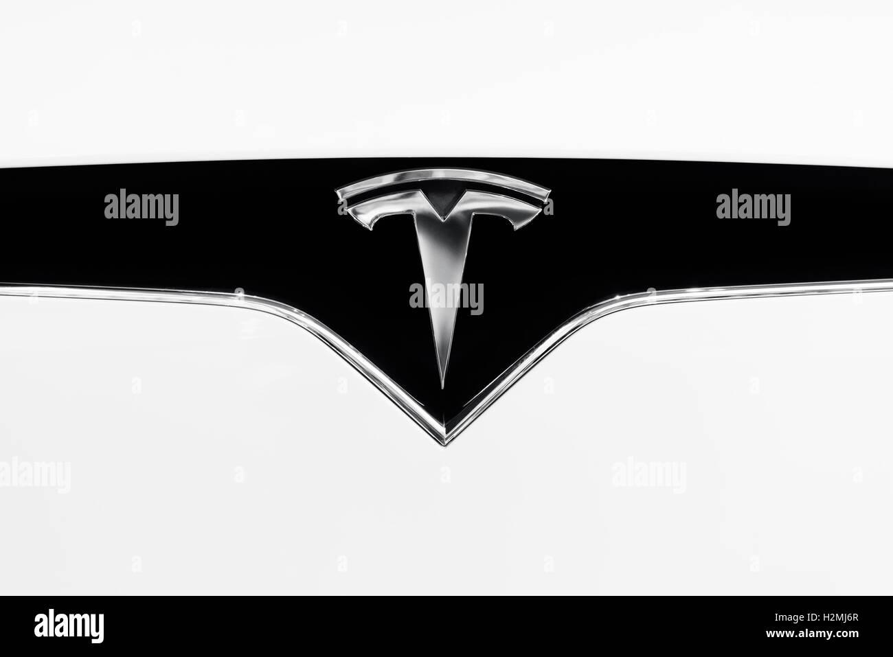 Tesla Motors electric car emblem on a hood of white 2017 Tesla X logo trademark closeup - Stock Image