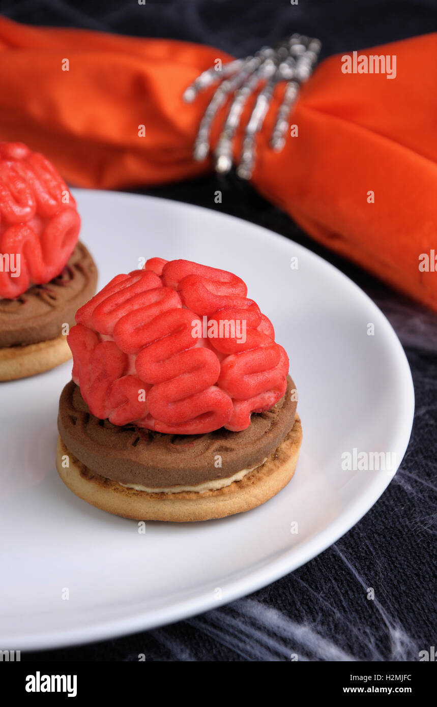 bloody brains out on the marzipan cookie sandwich on Halloween Stock Photo