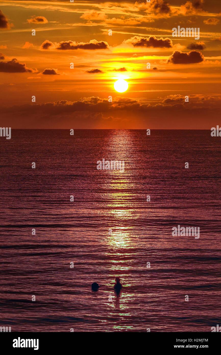 Jamaica, sunset, negril, 7 mile beach, swimming at caribbean - Stock Image