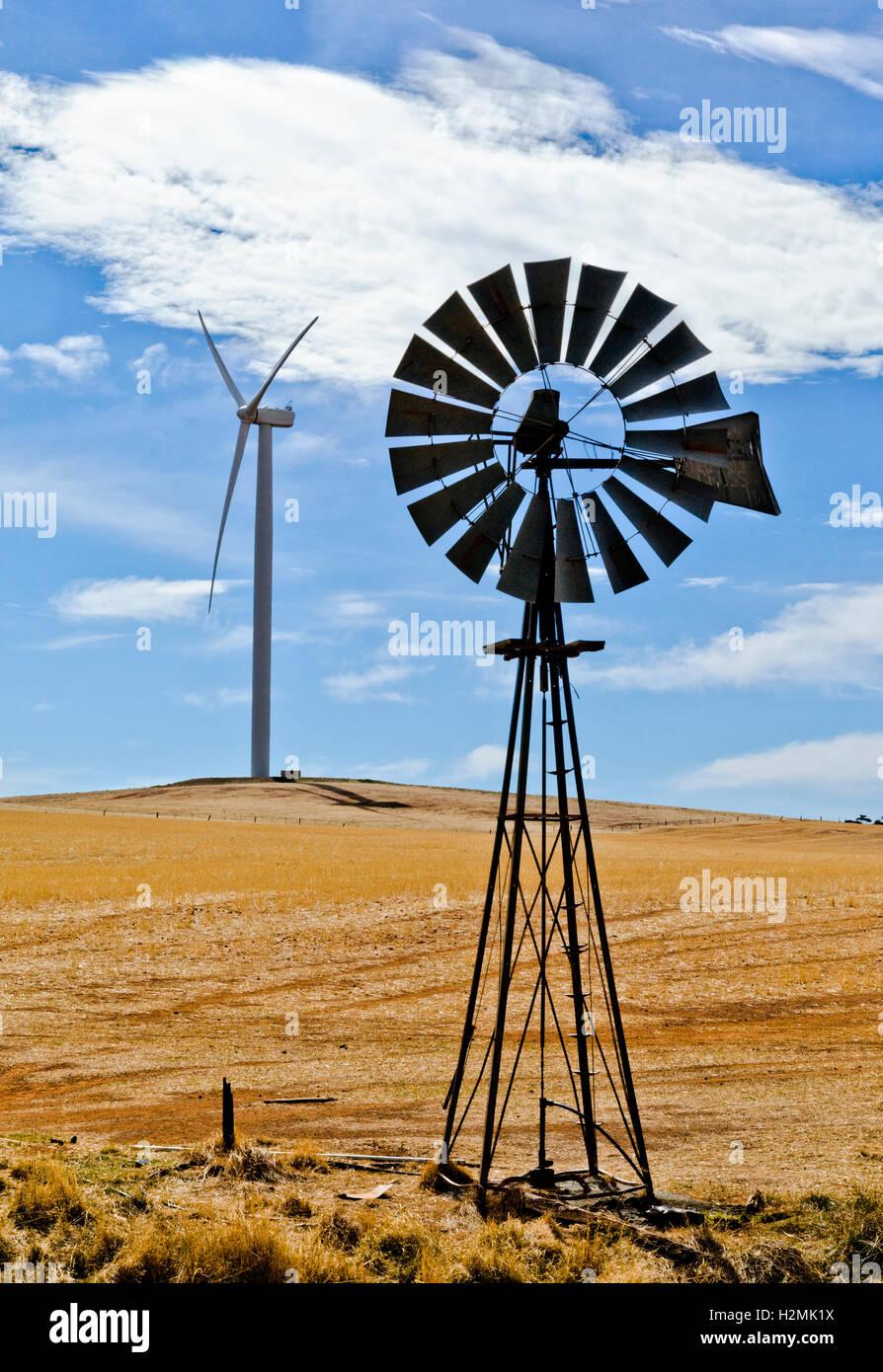 old windmill and modern wind turbine at the bluff range