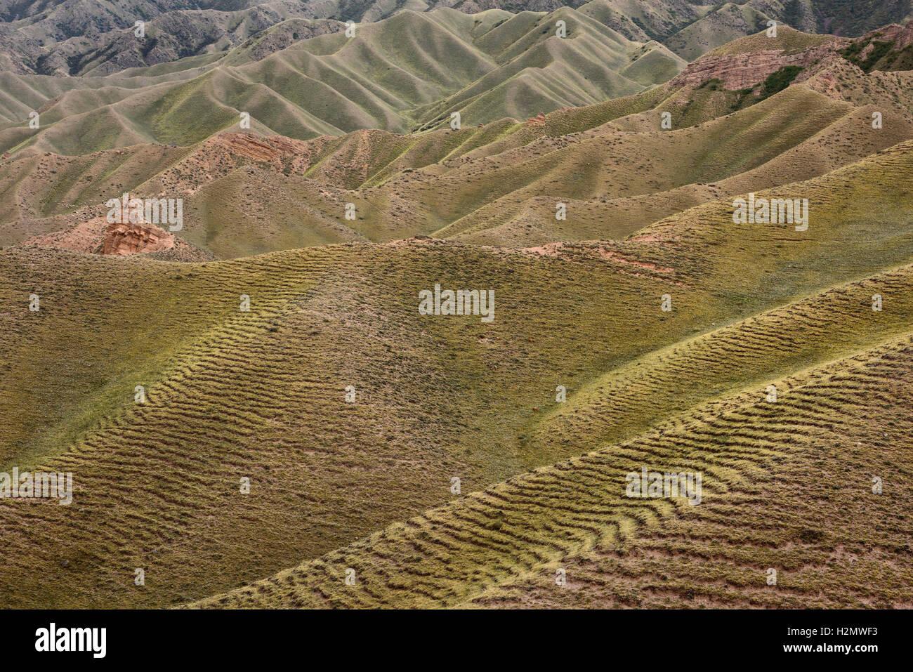 Abstract pastureland hills at Sopka Sarytau mountain east of Assy Plateau Kazakhstan - Stock Image