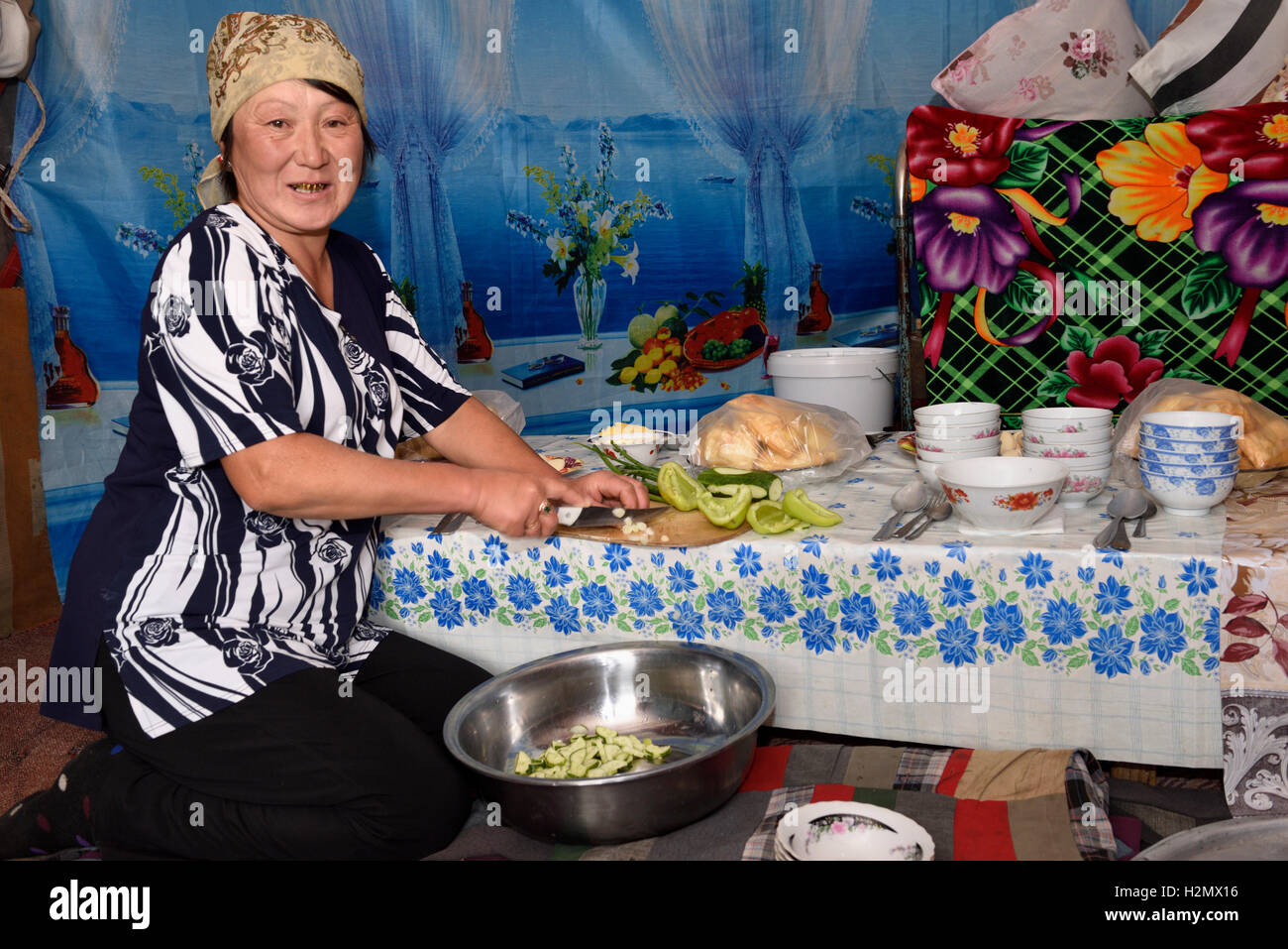 Kazakh woman preparing lunch for guests inside a yurt on the Assy Plateau Kazakhstan - Stock Image